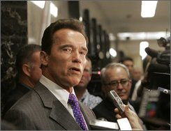 Gov. Arnold Schwarzenegger, talks to reporters outside his Capitol office in Sacramento, Calif., Tuesday, Sept. 8, 2008. The celebrity governor has spent the summer being bombarded by near-constant criticism from all sides for failing to lead the state out of the same kind of fiscal disaster he promised to solve after he replaced former Gov. Gray Davis. (AP Photo/Rich Pedroncelli)