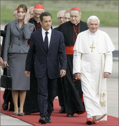 French President Nicolas Sarkozy, foreground left, and his wife Carla Bruni-Sarkozy, left, are seen with Pope Benedict XVI, right, upon his arrival at Orly airport, south of Paris, Friday, Sept.12, 2008. Pope Benedict XVI embarked Friday on his first visit to France as pontiff, urging French society to take Christian values into account despite the country's staunch, historic separation of church and state. (AP Photo/Michel Euler)