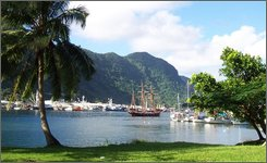 "In this July 2002 file photo, a sailing ship stands in the harbor at Pago Pago, American Samoa.  A reader-submitted question about American Samoa is being answered as part of an Associated Press Q&A column called ""Ask AP"". (AP Photo/David Briscoe, FILE)"