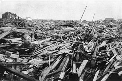 In this September 1900 file photo, a large part of the city of Galveston, Texas, is reduced to rubble after being hit by a surprise hurricane Sept. 8, 1900. More than 6,000 people were killed and 10,000 left homeless from the storm, the worst natural disaster in U.S. history. Hurricane Ike's eye was forecast to strike somewhere near Galveston late Friday, Sept. 12, 2008, or early Saturday, then head inland for Houston. (AP Photo/File)