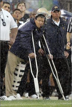 Notre Dame coach Charlie Weis watches from the sidelines on crutches as his team plays Michigan in the third quarter of NCAA college football action in South Bend, Ind., Saturday, Sept. 13, 2008. Weis was injured when he was hit by a player in the second quarter. (AP Photo/Michael Conroy)
