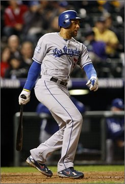 Los Angeles Dodgers' James Loney htis a three-run double against the Colorado Rockies in the ninth inning of the Dodgers' 7-2 victory in a baseball game in Denver on Friday, Sept. 12, 2008. (AP Photo/David Zalubowski)