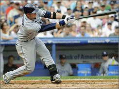 Tampa Bay Rays' Evan Longoria follows through on a two-run single during the fifth inning of the first game of a baseball doubleheader against the New York Yankees on Saturday, Sept. 13, 2008, at Yankee Stadium in New York. (AP Photo/Bill Kostroun)