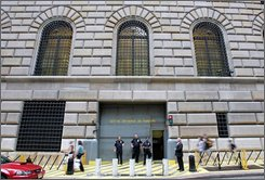  Security officers stand guard outside the Federal Reserve Bank of New York Saturday Sept. 13, 2008 where deliberations resumed as leading Wall Street executives and top U.S. financial officials tried to find a buyer or financing for the nation's No. 4 investment bank, Lehman Brothers, and to stop the crisis of confidence spreading to other U.S. banks, brokerages, insurance companies and thrifts. (AP Photo/David Goldman)