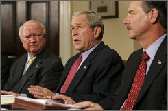  President Bush flanked by Secretary of Energy Samuel Bodman, left, and FEMA administrator David Paulison, speaks from the Roosevelt Room of the White House following a morning briefing on the latest developments with Hurircane Ike, Sunday, Sept. 14, 2008, in Washington. (AP Photo/Haraz N. Ghanbari)