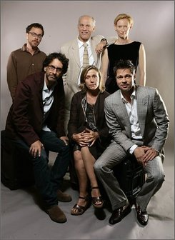 "In this image provided by Carlo Allegri for Focus Features, the cast and crew from ""Burn Before Reading,"" clockwise from first row left, directors Joel Coen and Ethan Coen, actors John Malkovich, Tilda Swinton,  Brad Pitt and Frances McDormand  pose for a cast photo during the International Film Festival in Toronto, Friday, Sept 5, 2008. (AP Photo/Carlo Allegri for Focus Features)"
