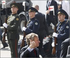 NATO Secretary-General Jaap de Hoop Scheffer gives thumbs up upon arrival to Tbilisi, Georgia Monday, Sept. 15, 2008. NATO's chief arrived in Georgia to show support for the pro-Western nation after its war with Russia. De Hoop Scheffer is leading a delegation of ambassadors from all 26 alliance members for a two-day visit starting Monday.  (AP Photo/ Shakh Aivazov)