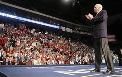 Republican presidential candidate Sen. John McCain, R-Ariz. applauds his supporters during a campaign rally in Jacksonville, Fla., Monday, Sept. 15, 2008. (AP Photo/Stephan Savoia)