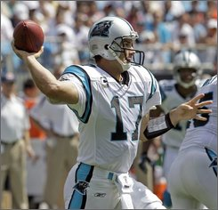 Carolina Panthers quarterback Jake Delhomme throws a pass during the second quarter of their 20-17 win over the Chicago Bears in an NFL football game in Charlotte, N.C., Sunday, Sept. 14, 2008. (AP Photo/Chuck Burton)