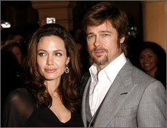 In this Feb. 2, 2008 file photo, Angelina Jolie and Brad Pitt arrive at the Santa Barbara International Film Festival  in Santa Barbara, Calif.  (AP Photo/Michael A. Mariant, file)