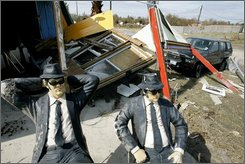 Blues Brothers statues sit in front of a commercial establishment destroyed by Hurricane Ike, Tuesday, Sept. 16, 2008, in Crystal Beach, Texas. (AP Photo/Tony Gutierrez)