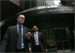 Businessmen leave an American International Group office building, Tuesday, Sept. 16, 2008 in New York.  Worries about AIG's well-being intensified Monday and early Tuesday after several ratings agencies downgraded the company. Lower ratings can add to the amount of money the already cash-strapped company has to set aside. (AP Photo/Mark Lennihan)