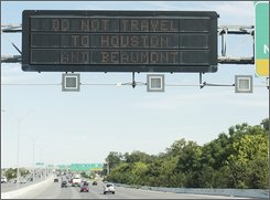 A sign north of Downtown San Antonio warns drivers not to travel to Houston or Beaumont due to limited fuel availability and other dangers associated with Hurricane Ike, Tuesday, Sept. 16, 2008. (AP Photo/Darren Abate)
