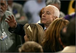 Republican presidential candidate Sen., John McCain, R-Ariz.,  listens to a supporter's question during a town hall style meeting in Orlando, Monday, Sept. 15, 2008. (AP Photo/Stephan Savoia)