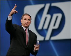 In this Nov. 12, 2007 file photo, Hewlett Packard Company CEO Mark Hurd gestures during a keynote address at Oracle Open World Conference in San Francisco. Hewlett-Packard Co. said Monday, Sept. 15, 2008, it plans to cut 24,600 jobs, or about 7.5 percent of its work force, over the next three years. This major restructuring is coming as HP integrates its newly acquired technology services company Electronic Data Systems Corp. (AP Photo/Paul Sakuma, file)