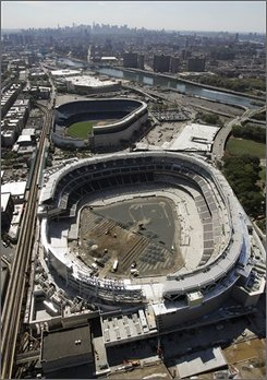  In this Sept. 8, 2008, file photo, the New York Yankees' new ballpark, bottom, is under construction next to venerable Yankee Stadium in New York. State Assemblyman Richard Brodsky said he will issue a report Tuesday, Sept. 16, finding that New York City manipulated the assessed value of the new stadium to get an Internal Revenue Service tax exemption. (AP Photo/Mark Lennihan, File)