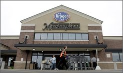 In this Sept. 11, 2006 file photo, a Kroger Marketplace super store is seen in West Chester, Ohio. Kroger Co., the nation's largest traditional grocery chain, on Tuesday, Sept. 16, 2008 said  its second-quarter profit rose 3.4 percent as a slowing economy prompted people to eat at home more often and try more store brands. (AP Photo/Al Behrman, file)