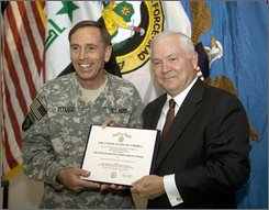U.S. Commanding General of Multinational Forces in Iraq, David Petraeus, left, is awarded for distinguished service by U.S. Secretary of Defense Robert Gates during a ceremony Monday, Sept. 15, 2008 on the outskirts of Baghdad. (AP Photo/Paul J. Richards, Pool)