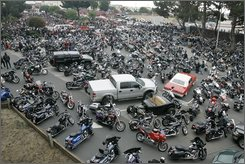 "Motorcycles fill a parking lot for the San Francisco Hells Angels'  leader funeral in Daly City, Calif., Monday, Sept. 15, 2008. Authorities say as many as 2,000 bikers are expected to attend the burial today of Mark ""Papa"" Guardado. Guardado was shot earlier this month outside a bar in San Francisco after a scuffle with man police say was a member of a rival Mongols Motorcycle Club. (AP Photo/Eric Risberg)"