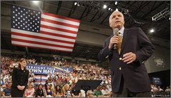 Republican presidential candidate, Sen., John McCain, R-Ariz., and his vice presidential running mate, Alaska Gov., Sarah Palin stand on stage during a town hall style meeting with supporters in Grand Rapids, Mich., Wednesday night, Sept. 17, 2008. (AP Photo/Stephan Savoia)