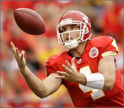 Kansas City Chiefs quarterback Tyler Thigpen recovers the ball after getting a bad snap during the fourth quarter of an NFL football game against the Oakland Raiders, Sunday, Sept. 14, 2008, in Kansas City, Mo. Oakland won the game 23-8. (AP Photo/Charlie Riedel)