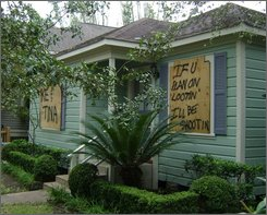 A house in Houston on Thursday, Sept. 18, 2008 with the windows boarded warns would-be intruders that they will be shot if they attempt to loot. (AP Photo/Peter Prengaman)
