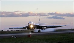 Russia's strategic bomber Tu-160 or White Swan, the largest supersonic bomber in the world, lands at Engels Air Base near Saratov, about 700 kilometers (450 miles) southeast of Moscow, Thursday, Aug. 7, 2008. NATO knows Russia's biggest supersonic bomber as the Blackjack, but when a pair of the sleek white aircraft unexpectedly touched down in Venezuela this week the world got its first good look at what is known here as the White Swan. (AP Photo/Misha Japaridze)