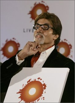 "Bollywood superstar Amitabh Bachchan gestures at a press conference to announce the ""Live Earth India"" event in Mumbai, India, Thursday, Sept. 18, 2008. Mumbai will play host to the next Live Earth concert on December 7, with Jon Bon Jovi and major Bollywood movie stars teaming up to build awareness about climate change in one of the world's fastest growing economies, organizers said Thursday. (AP Photo/Rajanish Kakade)"