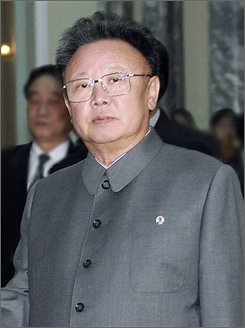 "In this Oct. 28, 2005 file photo released by China's Xinhua News Agnecy, North Korean leader Kim Jong Il, shakes hands with Chinese President Hu Jintao, unseen, before their talks in Pyongyang, North Korea. A North Korean diplomat has angrily denied that leader Kim Jong Il is ill. North Korean Foreign Ministry official Hyun Hak Bong says talk of Kim's illness is ""nonsense spread by bad people who don't wish our republic to go well."" (AP Photo/Xinhua, Yao Dawei, File)"
