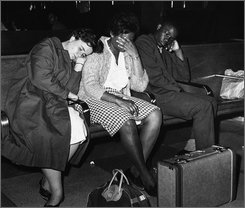 "In this May 20, 1961 file photo, three members of a racially mixed group of college student ""freedom riders"" catch a nap in the Birmingham, Ala., bus station after they were thwarted several times in attempts to board a bus to Montgomery, Ala.   Left to right are Susan Hermann, Etta Simpson and Frederick Leonard. All attend college in Nashville, Tenn. On Thursday Sept. 18, 2008, Tennessee State University made amends by presenting the former students, including Simpson and Leonard with honorary degrees, three of them posthumously.  (AP Photo/Horace Cort, File)"