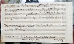 "A previously unknown piece of music by Mozart is displayed, discovered by a library as staff were going through its archives, Thursday, Sept. 18, 2008, in Nantes, western France.  Ulrich Leisinger, head of research at the International Mozarteum Foundation in Salzburg, Austria, said Thursday that there is no doubt that the single sheet was written by the composer and that it is ""really important."" He described the work as the preliminary draft of a musical composition. (AP Photo/David Vincent)"
