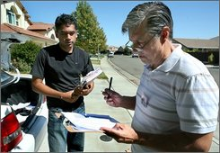 Rick Yorgason, right,a supporter of the proposed California ban on same-sex marriage,constitutional amendment. asks voter Kevin Patel, left, about his thoughts on gay marriage during a poll of voters in Elk Grove, Calif., on  Aug. 23, 2008. Proposed bans on same-sex marriage are on the ballot in three important states this fall, rousing passions on both sides, yet neither John McCain nor Barack Obama seem eager to push the issue high on their campaign agendas. (AP Photo/Steve Yeater)