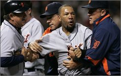 Detroit Tigers' Gary Sheffield, center, is escorted off the field by teammates after a during a benches clearing brawl in the seventh inning of a baseball game against the Cleveland Indians, Friday, Sept. 19, 2008, in Cleveland. (AP Photo/Tony Dejak)