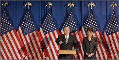 Republican presidential candidate Sen. John McCain, R-Ariz., accompanied by his running mate, Alaska Gov. Sarah Palin, gestures during a rally for business leaders, Friday, Sept. 19, 2008, in Green Bay, Wis.  (AP Photo/Mike Roemer)