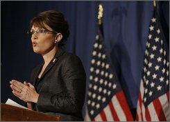 Republican vice presidential candidate, Alaska Gov. Sarah Palin, introduces her running mate, presidential candidate Sen., John McCain, R-Ariz., before he delivers a policy speech on the country's current economic crisis in Green Bay, Wis., Friday, Sept. 19, 2008. (AP Photo/Stephan Savoia)
