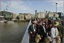 Liverymen and Freemen of the City of London re-enact their right to drive sheep across London Bridge, in central London, Friday Sept. 19, 2008. A herd of 15 Romney ewes was driven across by groups of 15 Freemen, some dressed in their official robes of office, to raise an estimated 40,000 British pounds for The Lord Mayor's Appeal. (AP Photo/Lefteris Pitarakis)
