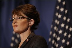 Republican vice presidential candidate, Alaska Gov., Sarah Palin, listens as her running mate, presidential candidate Sen. John McCain, R-Ariz., delivers a policy speech on the countries current economic crisis, Friday, Sept. 19, 2008, in Green Bay, Wis. (AP Photo/Stephan Savoia)