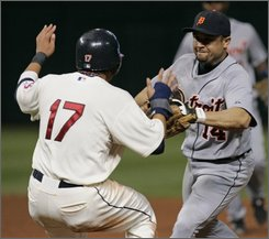 Cleveland Indians pitcher Fausto Carmona,center, punches Detroit Tigers' Gary Sheffield during a benches clearing brawl in the seventh inning in a baseball game, Friday, Sept. 19, 2008, in Cleveland. The Indians' Asdrubal Cabrera, left, and Victor Martinez, right, stay close. (AP Photo/Tony Dejak)