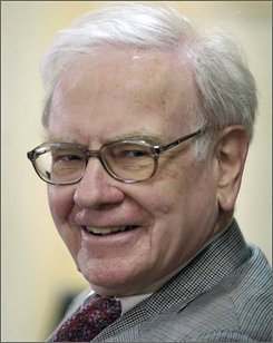 """This file photo from May 1, 2005 shows Berkshire Hathaway chairman Warren Buffett smiling at a news conference following the Berkshire annual shareholders meeting in Omaha, Neb. According to a new biographical book called """"The Snowball"""