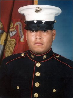 """This undated photo released by the U.S. Marines, shows Sgt. Rafael Peralta, 25. Peralta was being considered for a posthumous Medal of Honor, the United States' highest military award. Peralta was shot during a house-to-house search in Fallujah. Lying wounded on the floor of a home, he grabbed a grenade that had been lobbed in by an insurgent. The blast killed him. """"If he wouldn't have scooped up the grenade, the other three of us in the room that day would have been killed,"""" said former Cpl. Robert Reynolds, who was in Peralta's squad. Reynolds said Peralta sacrificed himself because """"he wanted to make sure we all went home."""" A committee reviewing the nomination could not agree on the award, citing questions over whether friendly fire from a comrade might have contributed to her son's death, Rosa Peralta, told the North County Times for its Wednesday, Sept. 17, 2008 edition. (AP Photo/U.S. Marines)"""