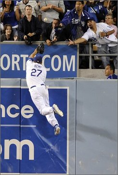 Los Angeles Dodgers center fielder Matt Kemp can't reach a ball hit for a two-run home run by San Francisco Giants' Bengie Molina during the fifth inning of a baseball game, Friday, Sept. 19, 2008, in Los Angeles. (AP Photo/Mark J. Terrill)