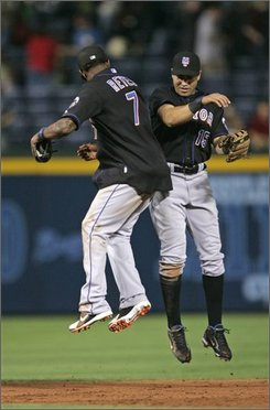 New York Mets Jose Reyes, left, and Carlos Beltran celebrate after defeating the Atlanta Braves 9-5 in a baseball game Friday, Sept. 19, 2008, in Atlanta. (AP Photo/John Bazemore)