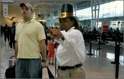 In this Nov. 21, 2007 file photo, Blake Haley, left, is directed to the check-in counter by Carol David, a customer service agent with Southwest Airlines, at Baltimore/Washington International Thurgood Marshall Airport in Linthicum, Md.  Southwest Airlines Co. led the industry in passenger satisfaction in the latest University of Michigan survey. (AP Photo/Jacquelyn Martin, file)