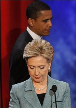 In this April 16, 2008 file photo, then Democratic presidential hopefuls, Sen. Hillary Rodham Clinton, D-N.Y., and Sen. Barack Obama, D-Ill., return from a commercial break during their debate at the National Constitution Center, in Philadelphia. (AP Photo/Charles Dharapak, File)