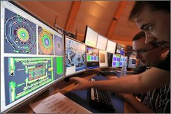 In this file photo dated Sept. 10, 2008, European Center for Nuclear Research (CERN) scientists control computer screens showing traces on Atlas experiment of the first protons injected in the Large Hadron Collider (LHC) during its switch on operation in CERN's control room, near Geneva, Switzerland. The world's largest atom smasher, which was launched with great fanfare earlier this month, has been damaged worse than previously thought and will be out of commission for at least two months, its operators said Saturday, Sept. 20, 2008. (AP Photo/Fabrice Coffrini, Pool, File)