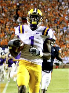 LSU wide receiver Brandon LaFell (1) scores a the game-winning touchdown against Auburn during the second half of an NCAA college football game in Auburn, Ala. on Saturday, Sept. 20, 2008. LSU won 26-21. (AP Photo/Butch Dill)