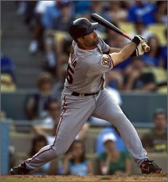 San Francisco Giants' Rich Aurilia hits an RBI single during the eleventh inning of a baseball game against the Los Angeles Dodgers in Los Angeles on Sunday, Sept. 21, 2008. (AP Photo/Hector Mata)
