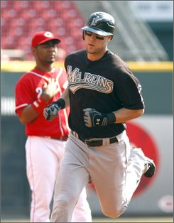 Cincinnati Reds' Joey Votto rounds the bases after hitting a solo home run off Florida Marlins pitcher Ricky Nolasco in the sixth inning of a baseball game, Monday, Sept. 22, 2008, in Cincinnati. The Reds won 7-5. (AP Photo/David Kohl)