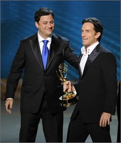 "Jeff Probst accepts the award for outstanding host for a reality or reality-competition program for his work on ""Survivor,"" from presenter, Jimmy Kimmel, left, at the 60th Primetime Emmy Awards Sunday, Sept. 21, 2008, in Los Angeles. (AP Photo/Mark J. Terrill)"