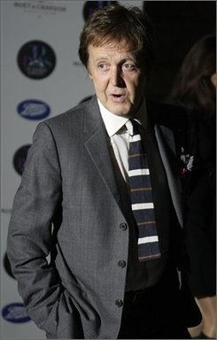 British musician Sir Paul McCartney arrives for the National Magazine Company's 30 Days of Fashion and Beauty viewing of 30 photographs taken by Mary McCartney, which takes place during London Fashion Week, London, Tuesday Sept. 16, 2008. (AP Photo/Joel Ryan)